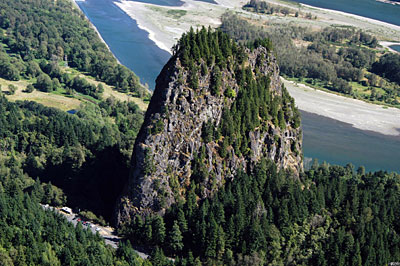Figure 10.19: Beacon Rock is part of the Boring Lava Field in Oregon.  It is the central core of a cinder cone whose outer layers were stripped away 57,000 years ago by the Missoula Floods.