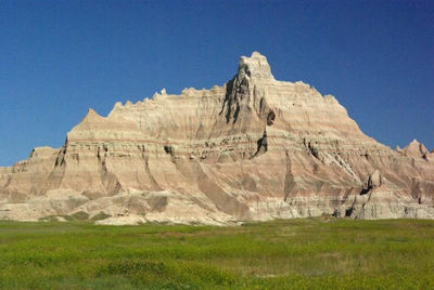Figure 2.14: The Brule Formation, exposed in Badlands National Park, is a sequence of fine-grained mudstones, claystones, and siltstones interbedded with freshwater carbonate rock, volcanic ash, and sandstone. These sediments were deposited during the Oligocene, 34-30 million years ago.