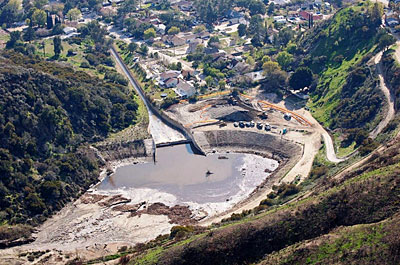 Figure 10.13: This debris basin in Los Angeles county is designed to capture the sediment, boulders, and other debris washed from the canyon during a storm.