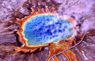 Figure 4.28: An aerial view of the Grand Prismatic Spring at Yellowstone National Park, the largest hot spring in North America, with an average diameter of 85 meters (275 feet). The spring's bright colors are caused by bacteria that live in the water.