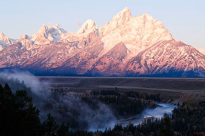 Figure 4.19: The Grand Tetons, some of the tallest mountains in Wyoming, as viewed from the Snake River Overlook. Grand Teton, the highest peak, is 4199 meters (13,775 feet) in elevation.