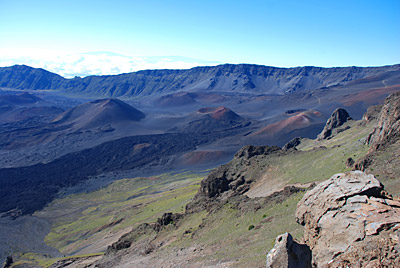 "Figure 4.24: Haleakalā, Maui. The summit ""crater"" of Haleakalā formed by erosional—not volcanic—processes. Two headward-eroding valleys were carved into the sides of the volcano and were later covered by the younger cinder cones seen today."