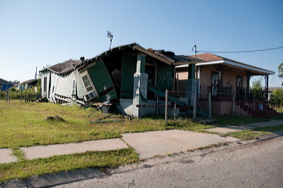Figure 10.23: This house in New Orleans was destroyed when it floated off its foundation during the 2005 flood.
