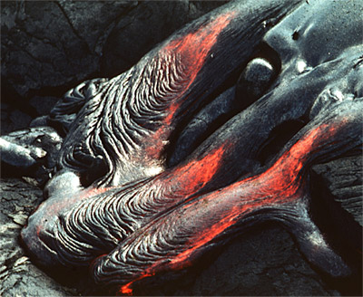Figure 2.35: The skin on a pahoehoe flow is deformed by the motion of the underlying molten lava. The resulting texture is ropey and lumpy.