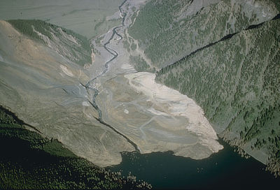 Figure 10.12: The landslide dam that led to the formation of Quake Lake (also known as Earthquake Lake). Today, the lake is 58 meters (190 feet) deep and 10 kilometers (6 miles) long.