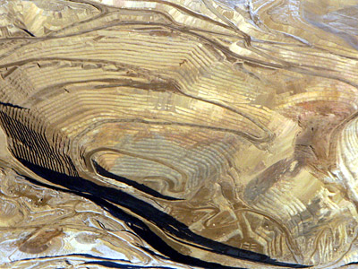 Figure 5.4: An aerial view of Round Mountain gold mine, an open pit mine in Nye County, Nevada. Round Mountain existed as an underground mine beginning in 1906, eventually being converted to an open pit sixty years later. The pit is about 2500 meters (9200 feet) wide and 1493 meters (4900 feet) deep.