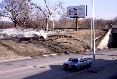 Figure 10.17: This slump occurred along a North Dakota roadcut after a spring thaw melted piles of snow on the upper bank, saturating the clay-rich soil and increasing its weight.