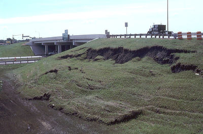 Figure 10.16: This slump near Interstate 29 in Fargo, North Dakota occurred in clay-rich materials used to construct the nearby overpass.