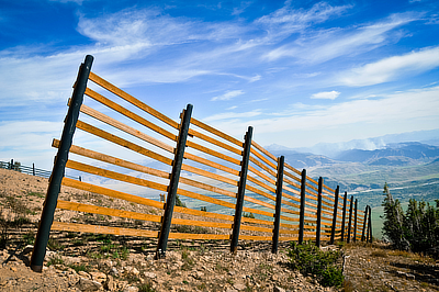 Figure 9.11: A snow fence near the Grand Tetons in Wyoming. Fences like these are used to force windblown snow to accumulate in a desired place, keeping it off roadways or collecting it for later use as a water supply.