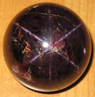Figure 5.15: The star garnet, Idaho's state gem, is a rare garnet that refracts light in the shape of a 4- or 6-pointed star when polished.