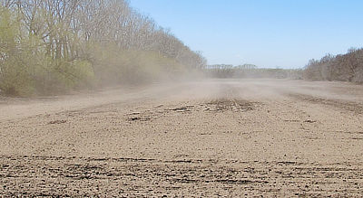 Figure 8.16: Dust rises from dry Ultisols in the Great Plains' Prairie Pothole Region.